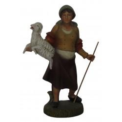 Pastora com ovelha ao colo