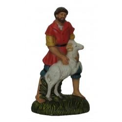 Pastor com ovelha à frente