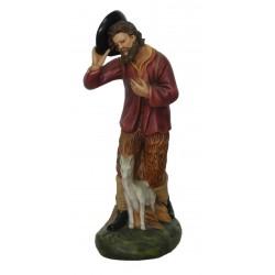 Pastor com mão no chapéue...