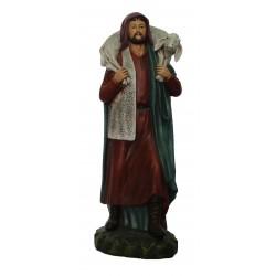 Pastor com ovelha aos ombros