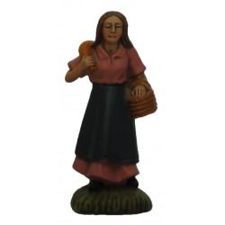 Pastora com cesta na mão e...
